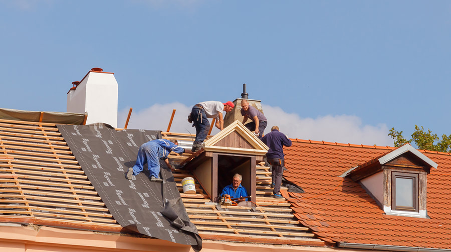 workers installing the roof